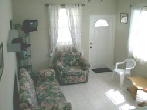 A sofa or sofa bed (in the larger 1 bedroom apartments), chair and coffee table along with a compact stereo and satellite TV, provide the comforts in the living room.