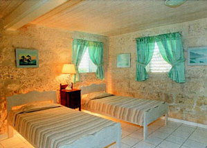 Coral stone walls of Seaside bedroom.